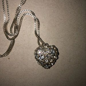 Long silver Fossil heart necklace